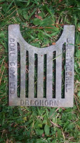 a drain cover marked Bourtreehill Coal Coy Ltd, Dreghorn seen at Whitrig Bog, Berwickshire